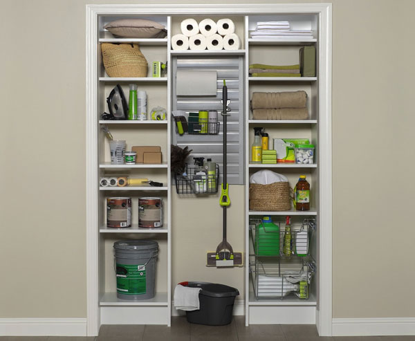 Cleaning supplies organized in hall closet with custom shelving