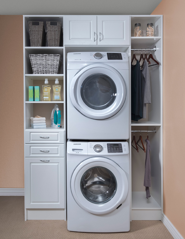 Built-in laundry room cabinets with hanging rods for clean clothes