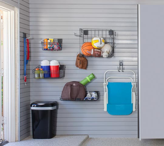 Accessories installed on slatwall organization system in garage