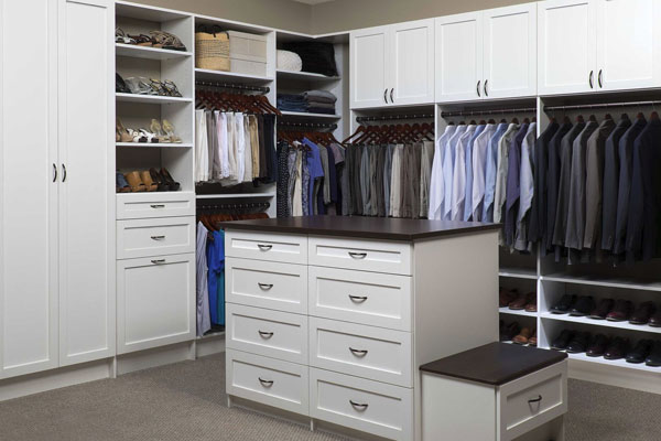 Classic white closet organization system with center island for storage